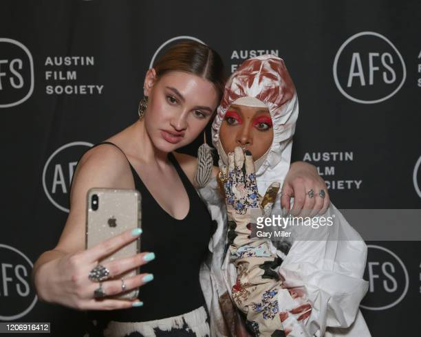 Erykah Badu poses with a fan during the Austin Film Society's 20th annual Texas Film Awards at Creative Media Center at Austin Studios on March 12...