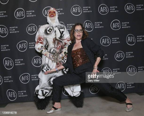 Erykah Badu receives the Soundtrack Award from Emcee Parker Posey during the Austin Film Society's 20th annual Texas Film Awards at Creative Media...