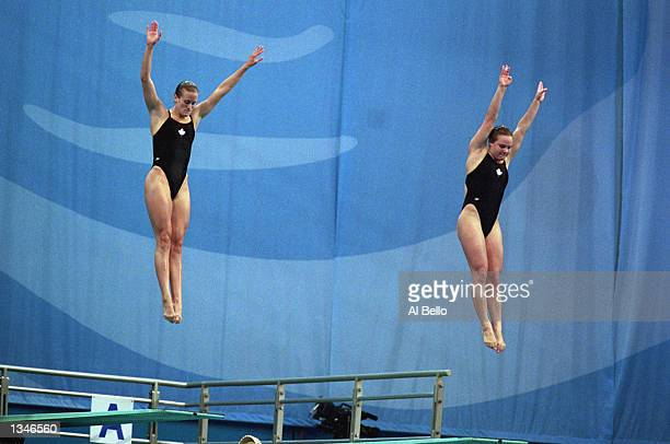 Eryn Bulmer and Blythe Hartley of Canada perform their dive in the Women's Synchronized 3m Springboard during the Sydney 2000 Olympic Games on...