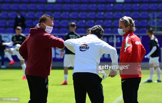 Erzgebirge Aue coach Dirk Schuster and SV Sandhausen coach Uwe Koschinat greet each other with a elbow prior to the Second Bundesliga match between...
