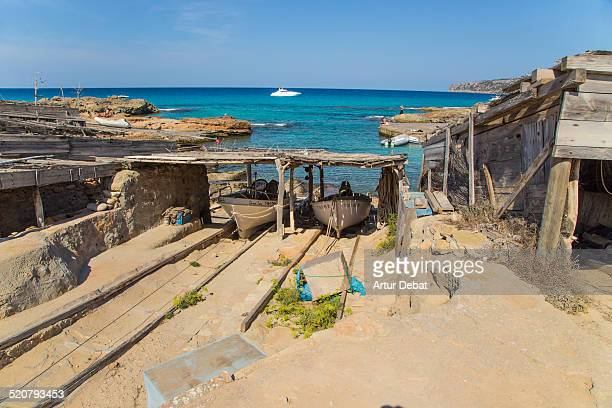 Es Calo beach in Formentera with fisherman boats