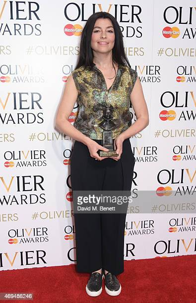Es Devlin winner of the Best Set Design award for 'The Nether' poses in the winners room at The Olivier Awards at The Royal Opera House on April 12...