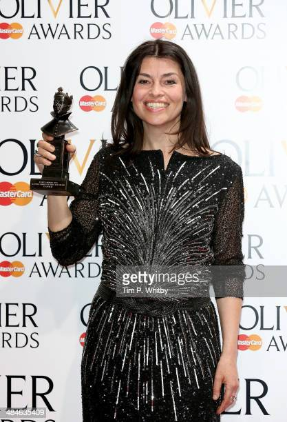 Es Devlin with her award for Best XL Video for Best Set Design for Chimerica poses in the press room at the Laurence Olivier Awards at The Royal...