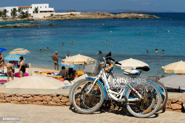 Es Pujols beach Formentera Bicycle Panoramic view parasol deck chair tourism holiday