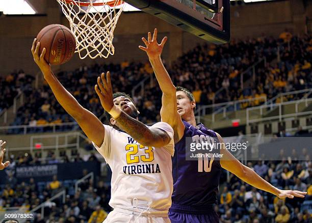 Esa Ahmad of the West Virginia Mountaineers lays one in against Vladimir Brodziansky of the TCU Horned Frogs during the game at the WVU Coliseum on...