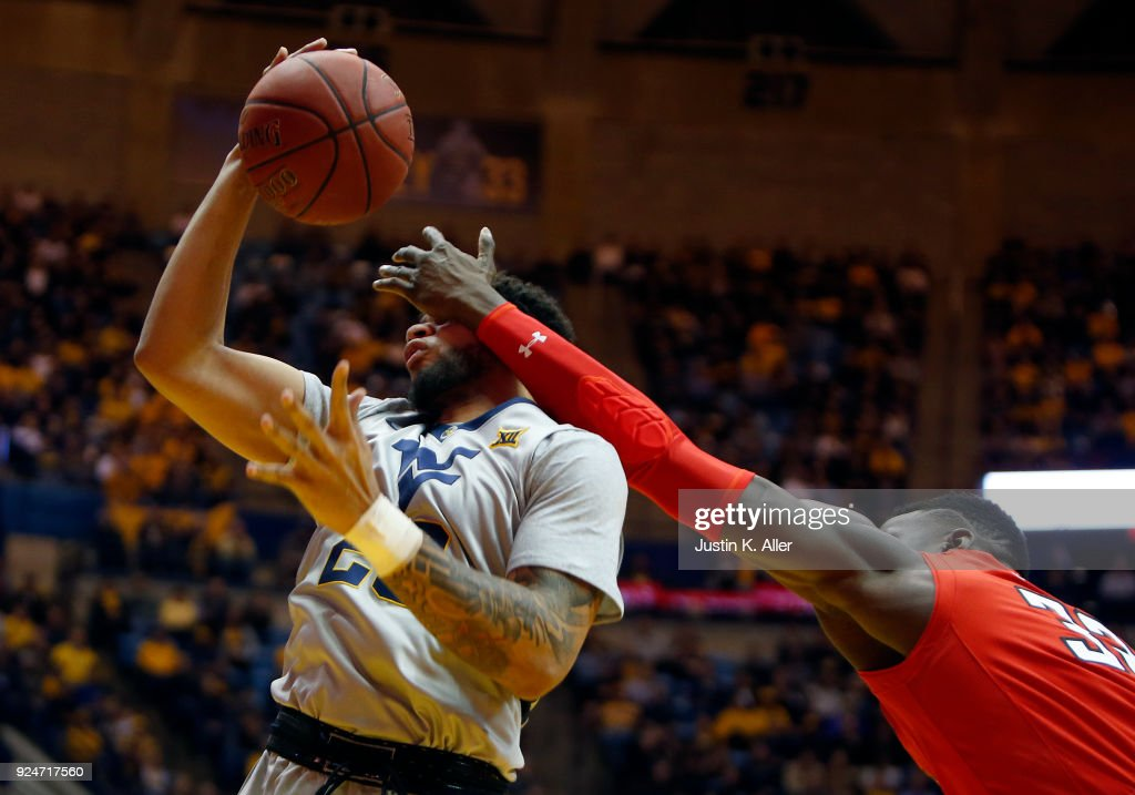 Esa Ahmad #23 of the West Virginia Mountaineers pulls down a rebound against Norense Odiase #32 of the Texas Tech Red Raiders at the WVU Coliseum on February 26, 2018 in Morgantown, West Virginia.