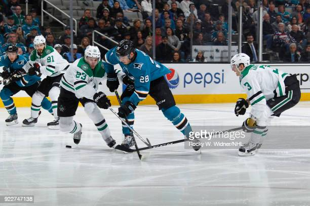 Esa Lindell of the Dallas Stars and Timo Meier of the San Jose Sharks skate after the puck at SAP Center on February 18 2018 in San Jose California