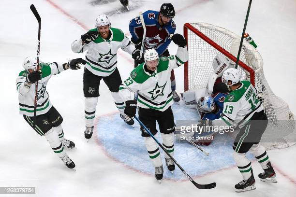 Esa Lindell of the Dallas Stars celebrates with his teammates after scoring a goal past Pavel Francouz of the Colorado Avalanche during the second...