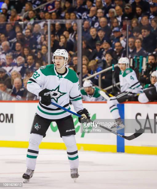 Esa Lindell of the Dallas Stars keeps an eye on the play during third period action against the Winnipeg Jets at the Bell MTS Place on January 6 2019...