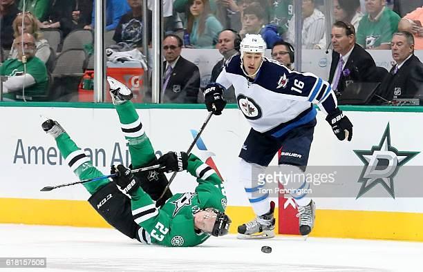 Esa Lindell of the Dallas Stars passes the puck against Shawn Matthias of the Winnipeg Jets at American Airlines Center on October 25 2016 in Dallas...