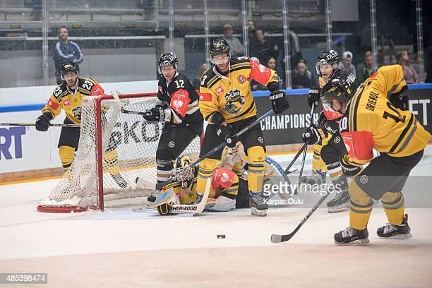Esa Pirnes and Mika Pyorala of Karpat Oulu and Andreas Driendl David Fischer and Herberts Vasiljevs of Krefeld Pinguine during the Champions Hockey...