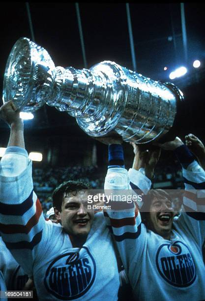 Esa Tikkanen and Jari Kurri of the Edmonton Oilers celebrate with the Stanley Cup Trophy after the Oilers defeated the Philadelphia Flyers in Game 5...