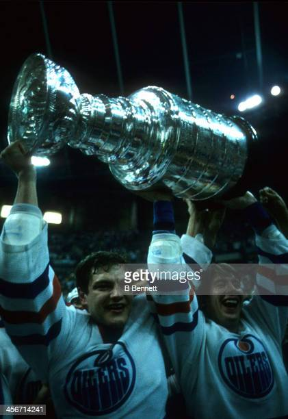 Esa Tikkanen and Jari Kurri of the Edmonton Oilers celebrate with the Stanley Cup after the Oilers defeated the Philadelphia Flyers in Game 7 of the...