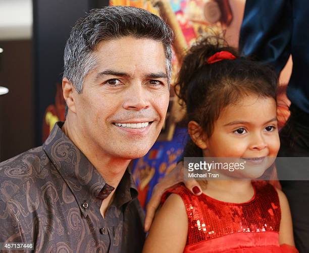 Esai Morales and daughter Mariana Oliveira Morales arrive at the Los Angeles premiere of Book Of Life held at Regal Cinemas LA Live on October 12...