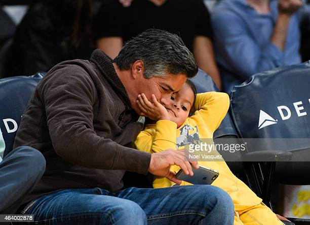 Esai Morales and his daughter Mariana Oliveira Morales attend a basketball game between the Brooklyn Nets and the Los Angeles Lakers at Staples...