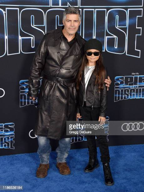Esai Morales and Mariana Oliveira Morales arrive at the Premiere Of 20th Century Fox's Spies In Disguise at El Capitan Theatre on December 4 2019 in...