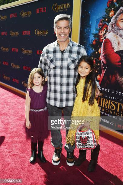 Esai Morales and Mariana Oliveira Morales attend The Christmas Chronicles Premiere on November 12 2018 in Los Angeles California