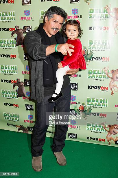 Esai Morales attends the Delhi Safari Los Angeles premiere with his daughter Mariana Oliveira Morales at Pacific Theatre at The Grove on December 3...