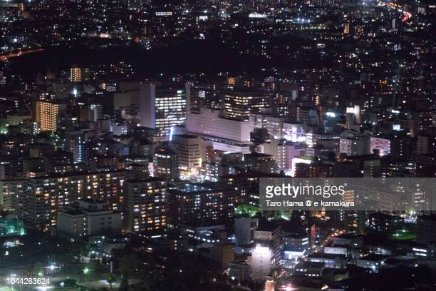 esaka area in suita city in osaka prefecture in japan night time aerial view from airplane - region kinki stock-fotos und bilder