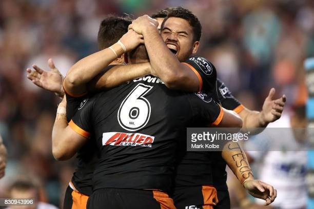 Esan Marsters and Tuimoala Lolohea of the Tigers celebrate after Tuimoala Lolohea scored a try during the round 23 NRL match between the Wests Tigers...