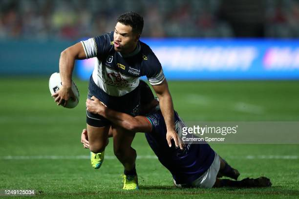 Esan Marsters of the Cowboys is tackled during the round five NRL match between the New Zealand Warriors and the North Queensland Cowboys at Central...
