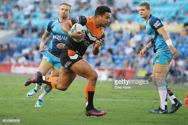Esan Marsters of the Tigers makes a break to score a try during the round 21 NRL match between the Gold Coast Titans and the Wests Tigers at Cbus...