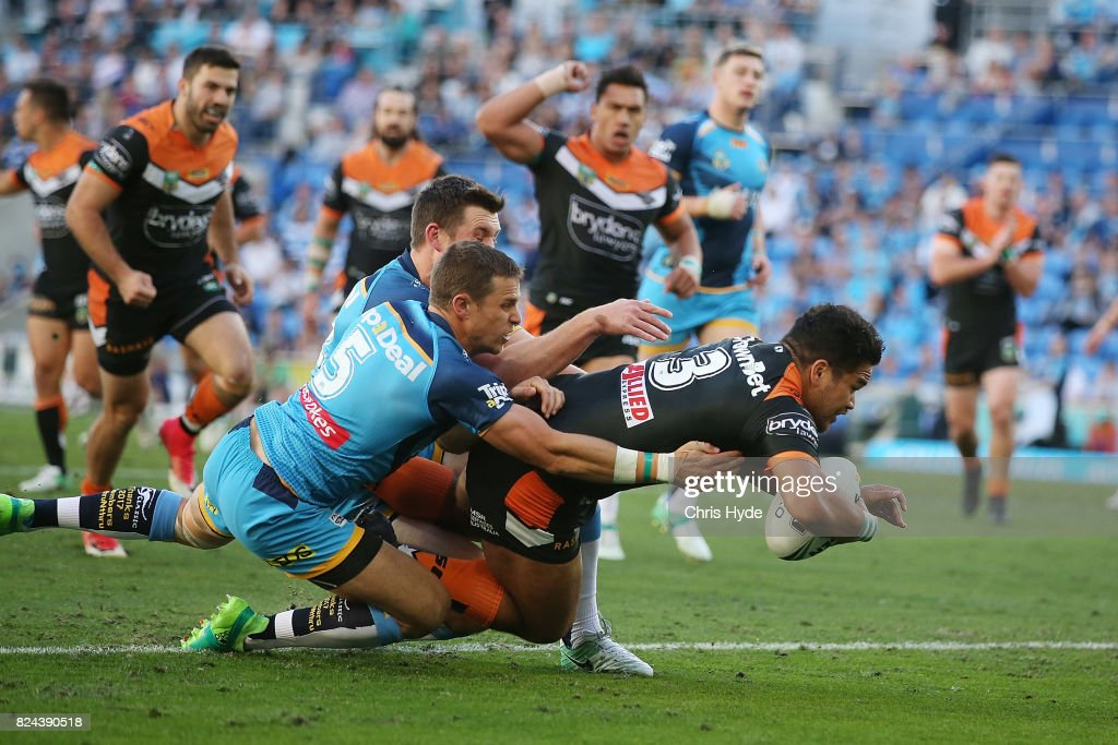 Esan Marsters of the Tigers scores a try during the round 21 NRL match between the Gold Coast Titans and the Wests Tigers at Cbus Super Stadium on July 30, 2017 in Gold Coast, Australia.