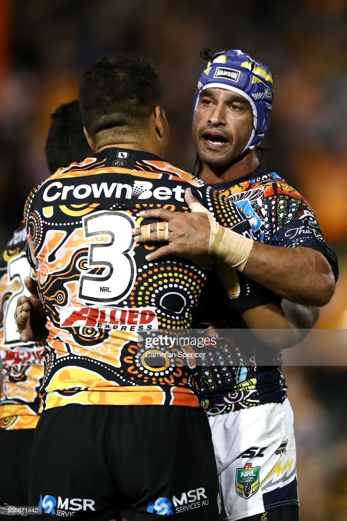 Esan Nike Marsters of the Tigers and Johnathan Thurston of the Cowboys embrace following the round 10 NRL match between the Wests Tigers and the North Queensland Cowboys at Leichhardt Oval on May 10, 2018 in Sydney, Australia.