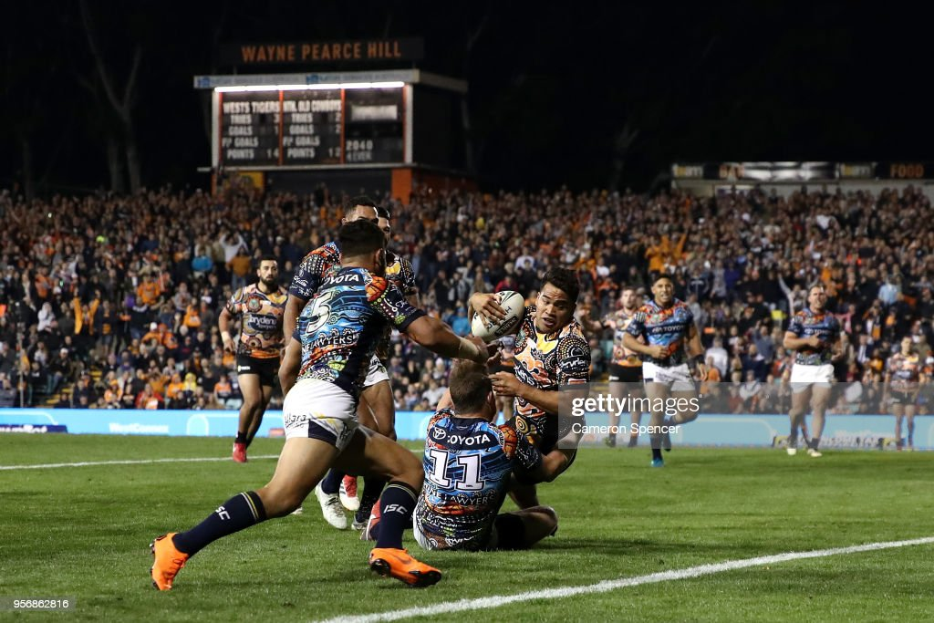 Esan Nike Marsters of the Tigers scores a try during the round 10 NRL match between the Wests Tigers and the North Queensland Cowboys at Leichhardt Oval on May 10, 2018 in Sydney, Australia.