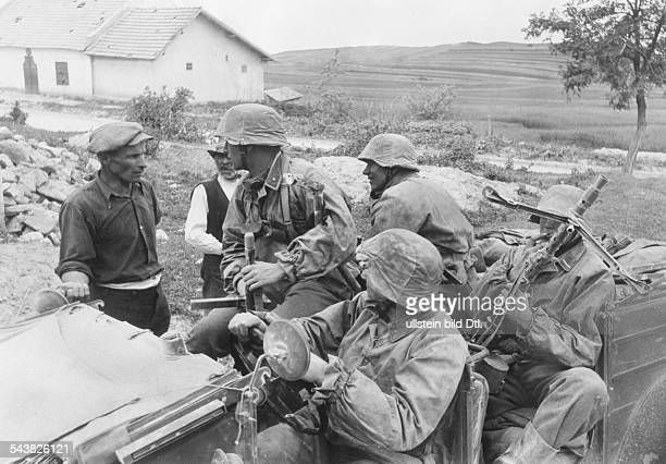 2 WW esatern front beginning of campaign against soviet union theater of war Grenadiers of the WaffenSS talking with ukrainian villagers neasr...