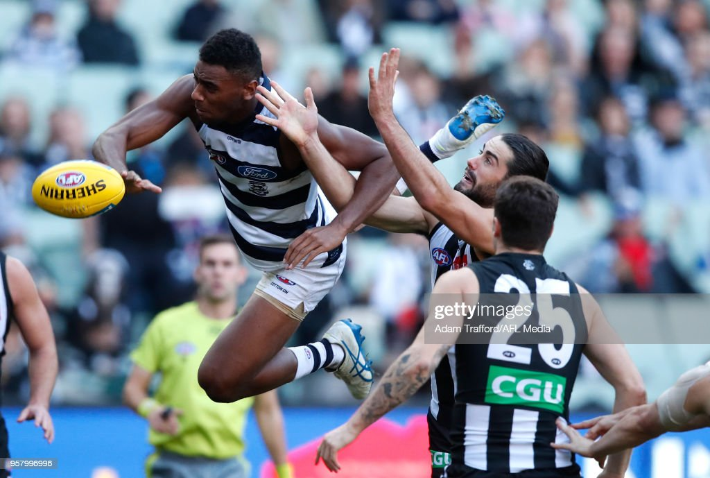 Esava Ratugolea of the Cats flies for the ball over Brodie Grundy of the Magpies during the 2018 AFL round eight match between the Collingwood Magpies and the Geelong Cats at the Melbourne Cricket Ground on May 13, 2018 in Melbourne, Australia.