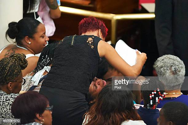 Esaw Garner cries during a funeral service for her husband Eric Garner held at Bethel Baptist Church on July 23 2014 in the Brooklyn borough of New...