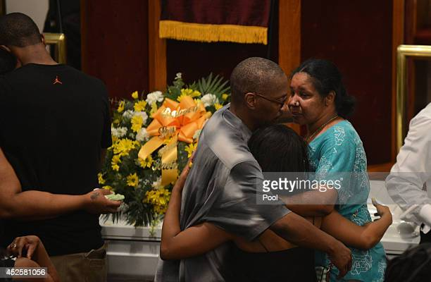 Esaw Garner is consoled by family members at the funeral service for her husband Eric Garner held at Bethel Baptist Church on July 23 2014 in the...