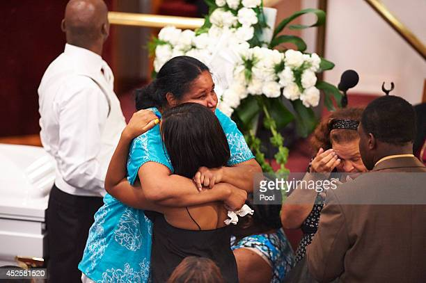 Esaw Garner receives a hug during a funeral service for her husband Eric Garner held at Bethel Baptist Church on July 23 2014 in the Brooklyn borough...