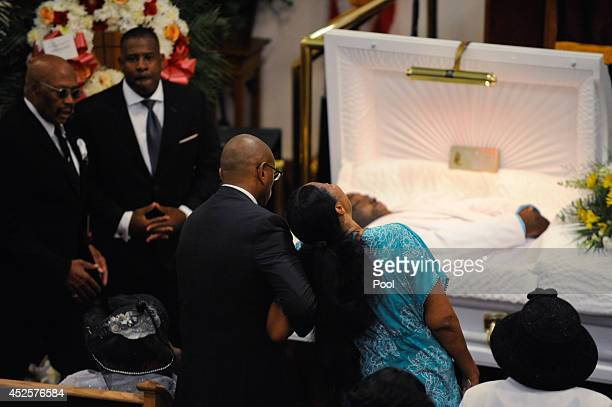 Esaw Garner wife of Eric Garner is consoled as she sees her husband for the last time during his funeral service held at Bethel Baptist Church on...