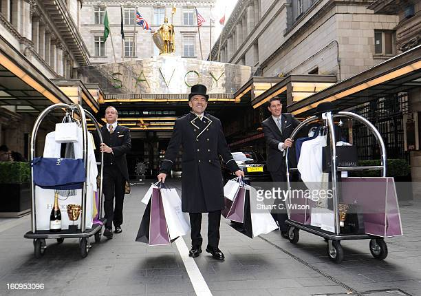 Escada Asprey Charles Worthington Lancome Hackett and Taittinger load in and set up the EE British Academy Awards style suites at The Savoy Hotel on...