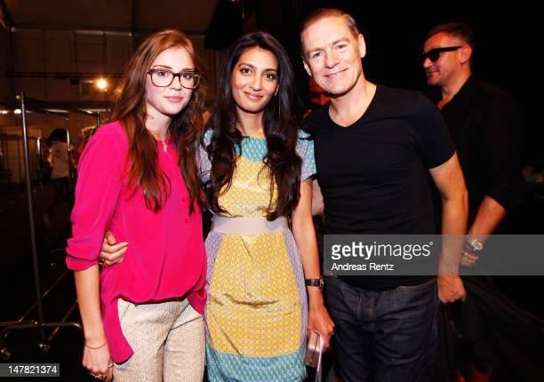 Escada Sport designer Madeleine Schaefer Bryan Adams and Megha Mittal pose backstage at the Escada Show at the MercedesBenz Fashion Week...