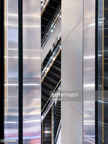 escalator aerial view - liyao xie stock pictures, royalty-free photos & images