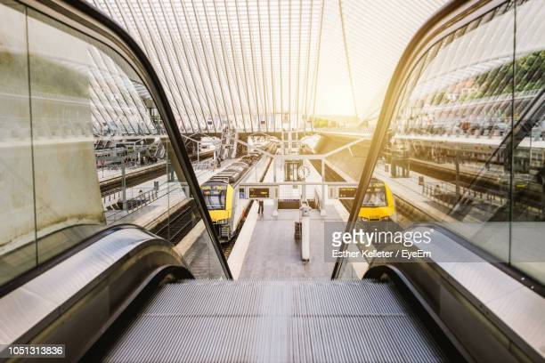 escalator at railroad station - liege stock pictures, royalty-free photos & images
