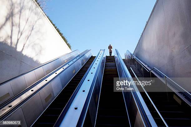 escalator going up - escalator stock pictures, royalty-free photos & images