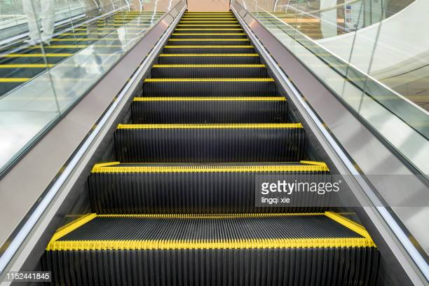 escalator in the mall - escalator stock pictures, royalty-free photos & images