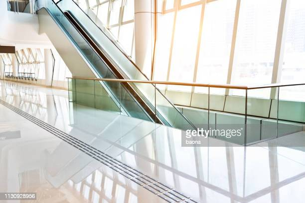 escalator on modern office building - office background stock pictures, royalty-free photos & images