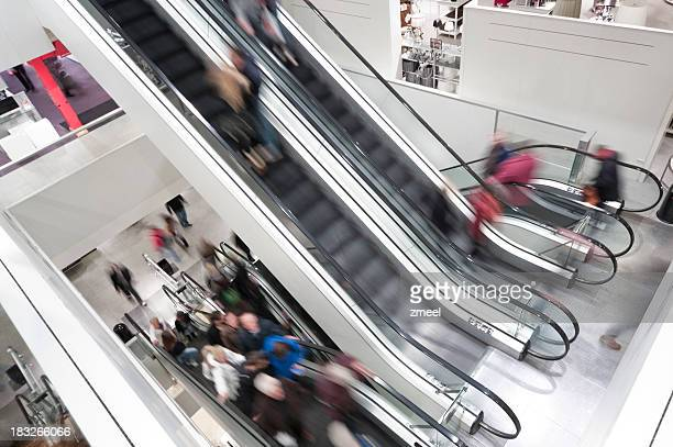 escalator shopping mall - megastore stock photos and pictures