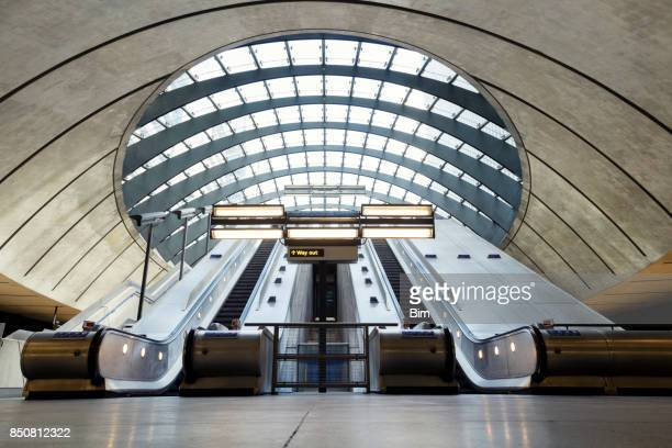 escalators, canary wharf, london, uk - canary wharf stock photos and pictures