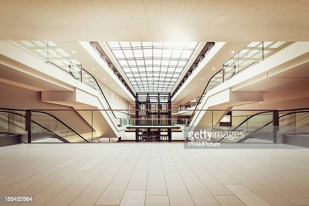 escalators in a clean modern shopping mall - indoors stock pictures, royalty-free photos & images