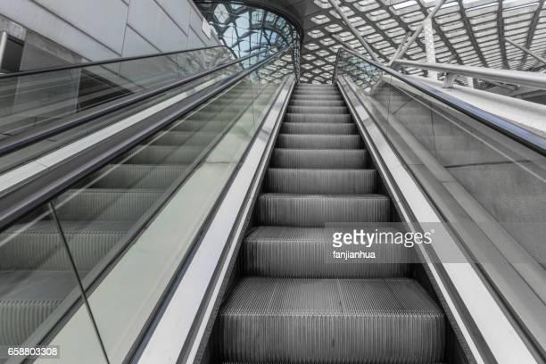 Escalators in a clean modern shopping mall