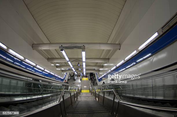 Escalators inside a Madrid Metro station.