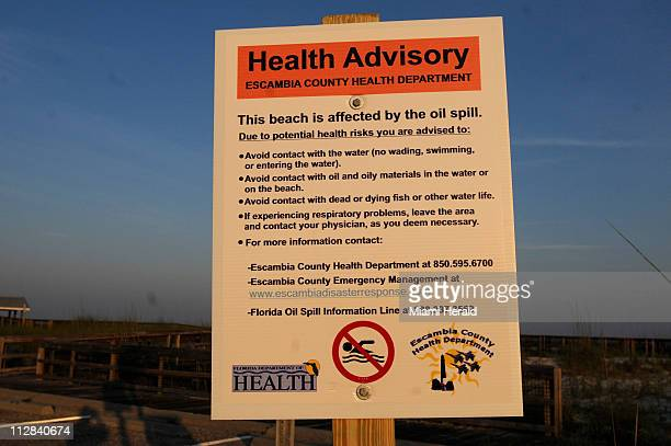 Escambia County Health Department placed health advisory signs at all the state beaches along Perdido Key in Florida after new tar was found Tuesday...