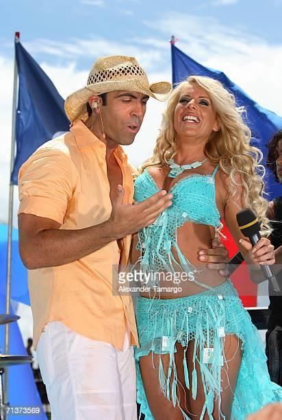 Escandalo TV host Felipe Viel and singer Lorena Herrera on stage during TeleFutura's Reventon Del 4 De Julio show special live from the Doubletree...