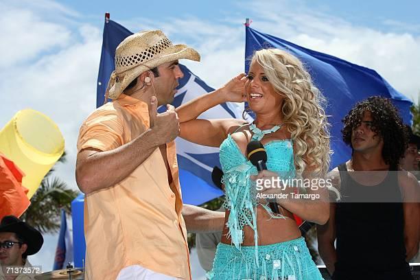 Escandalo TV host Felipe Viel and singer Lorena Herrera on stage during TeleFutura's 'Reventon Del 4 De Julio show special live from the Doubletree...